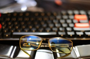 Computer glasses resting on a keyboard